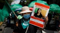 A woman holds a poster with a picture of Gabriela Guadalupe Ramirez, who went missing two months ago, during a protest against…