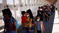 FILE PHOTO: Migrants from Central America, who were previously expelled from the U.S. and sent back to Mexico under Title 42,…