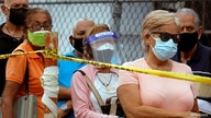 FILE PHOTO: People wait on a street outside the Regional Government Health Corporation turned into a mass vaccination centre to…