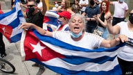 Cuban residents in Costa Rica demonstrate in front of the US embassy in San Jose, on July 13, 2021 asking for a military and…