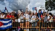 People protest to show support for Cubans demonstrating against their government, in Miami, on July 14, 2021. - One person has…