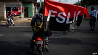 Members of the Sandinista Youth take part in a march at Altagracia neighborhood in Managua to celebrate the 42nd anniversary of…