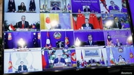 ASEAN leaders are seen on a screen as they attend the 4th Regional Comprehensive Economic Partnership Summit as part of the…
