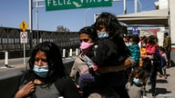FILE PHOTO: Asylum-seeking migrants from Central America, who were airlifted from Brownsville to El Paso, Texas, and deported…