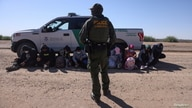 A group of asylum seekers from Mexico, Cuba and Haiti are detained by U.S. Border Patrol in San Luis, Arizona, U.S., April 19,…