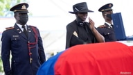 Haiti's former First Lady Martine Moise mourns during the funeral of her husband, late Haitian President Jovenel Moise who was…