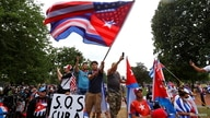 Protestors wave American and Cuban flags as they hold a protest calling for the U.S. to support protesters in Cuba, in…
