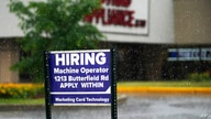 FILE - In this June 24, 2021 file photo, a hiring sign is displayed in Downers Grove, Ill. The number of Americans filing for…