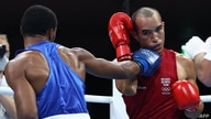 Refugee Olympic Team's Eldric Sella Rodriguez (red) and Dominican Republic's Euri Cedeno Martinez fight during their men's…
