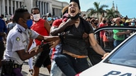 A man is arrested during a demonstration against the government of Cuban President Miguel Diaz-Canel in Havana, on July 11,…
