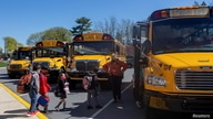 FILE PHOTO: Students are led onto the bus after the school day ends at Kratzer Elementary School in Allentown, Pennsylvania, U…