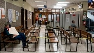 People wait to be care at a clinic in San Jose, on May 18, 2020. - Costa Rica did not adopt compulsory quarantines or strong…
