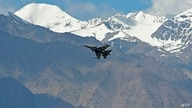 An Indian fighter jet flies over Leh, the joint capital of the union territory of Ladakh, on June 26, 2020. - India…