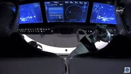 This NASA video frame grab image shows SpaceX's Crew Dragon spacecraft with NASA astronauts Douglas Hurley and Robert Behnken…