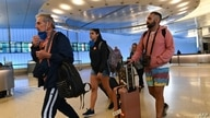 (FILES) In this file photo taken on March 13, 2020 Passengers arrive at Los Angeles Airport international terminal hours before…