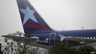 An air plane of Latam Argentina airline sits on the tarmac of the Jorge Newbery airport in Buenos Aires on July 22, 2020 as…