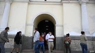 People leave after attending a mass in honour of the victims of the novel coronavirus COVID-19, at the San Vicente Martir…