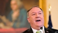 US Secretary of State Mike Pompeo speaks during a news conference to announce the Trump administration's restoration of…
