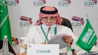 This handout picture released by G20 Saudi Arabia on September 22, 2020, shows Saudi Minister of Commerce Majid al-Qasabi…