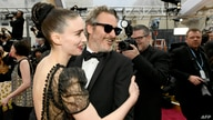 HOLLYWOOD, CALIFORNIA - FEBRUARY 09: (L-R) Rooney Mara and Joaquin Phoenix attends the 92nd Annual Academy Awards at Hollywood…