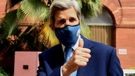 US climate envoy John Kerry gesture as he arrives at the Ministry of Finance for a meeting with Indian Finance Minister Nirmala…