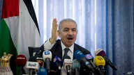 Palestinian Prime Minister Mohammed Shtayyeh, chairs a cabinet meeting in the Jordan Valley village of Fasayil, Monday, Sept…