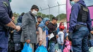 Migrants wait to board on buses outside Moria camp on their way to the port of Mytilene, on the northeastern Aegean island of…