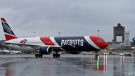 The New England Patriots football team's jet taxis on the tarmac, Thursday, April 2, 2020, at Logan Airport, in Boston, after…