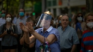 People applaud at demonstrators during a drive-in protest organised by Spain's far-right Vox party against the Spanish…