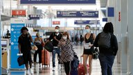 Travelers walk through in Terminal 3 at O'Hare International Airport Tuesday, June 16, 2020, in Chicago. Beginning June 16 at…
