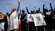 Melina Abdullah, left, of Black Lives Matter Los Angeles, leads a crowd in a raising of fists Monday, June 8, 2020, in Los…