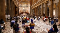 People attend a vigil prayer for the deceased would be migrants in Rome's Basilica of Our Lady in Trastevere on the World Day…