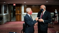 Director of the National Institute of Allergy and Infectious Diseases Dr. Anthony Fauci speaks with Dr. Robert Redfield,…