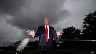President Donald Trump speaks with reporters before walking to Marine One on the South Lawn of the White House, Friday, July 31…