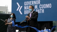 New York Gov. Andrew Cuomo does a ceremonial ribbon cutting for the opening of a bicycle and pedestrian path across the Gov…