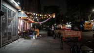 Chairs and tables are set up on a sidewalk and part of a roadway outside Antojitos Mexican restaurant, Wednesday, July 1, 2020,…