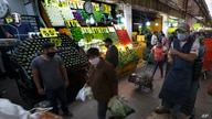 People shop at at the Central de Abasto wholesale food market in Mexico City, Friday, June 26, 2020. As the pandemic swamps…