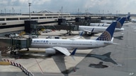 United Airlines planes are parked at gates at Newark Liberty International Airport in Newark, N.J., Wednesday, July 1, 2020. …