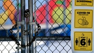 A chain-link fence lock is seen on a gate at a closed Ranchito Elementary School in the San Fernando Valley section of Los…