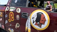 Rodney Johnson of Chesapeake, Va., stands with his truck outside FedEx Field in Landover, Md., Monday, July 13, 2020. The…