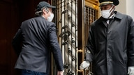 Michael Cohen arrives at his Manhattan apartment, Thursday, May 21, 2020, in New York. President Donald Trump's longtime…