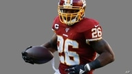 Adrian Peterson runs with the ball as Washington Redskins running back, graphic element on gray