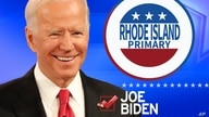 JOE BIDEN, as Democratic presidential candidate, over RHODE ISLAND PRIMARY lettering on button and checkmark, on texture,…