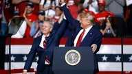 FILE - In this Feb. 28, 2020 file photo, Sen. Lindsey Graham, R-S.C., left, stands onstage with President Donald Trump during a…