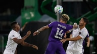 Inter Miami defender Andres Reyes, left, Orlando City forward Dom Dwyer (14) and Inter Miami defender Nicolas Figal, right,…