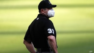 umpire Carlos Torres (37) is shown wearing a face covering during an Atlanta Braves inter squad baseball Monday, July 13, 2020,…