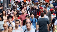 FILE - In this Aug. 22, 2019, file photo, people walk through New York's Times Square. The population of non-Hispanic whites in…