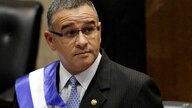 FILE - In this June 1, 2012 file photo, El Salvador's President Mauricio Funes stands in the National Assembly before speaking…