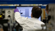 A lab technician looks at a computer screen during research on coronavirus, COVID-19, at Johnson & Johnson subsidiary Janssen…