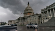 Dark clouds and heavy rain sweep over the U.S. Capitol in Washington, Monday, Aug. 3, 2020, as Tropical Storm Isaias pushes…